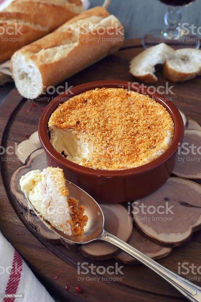 Cooking Camembert fondue stock photo