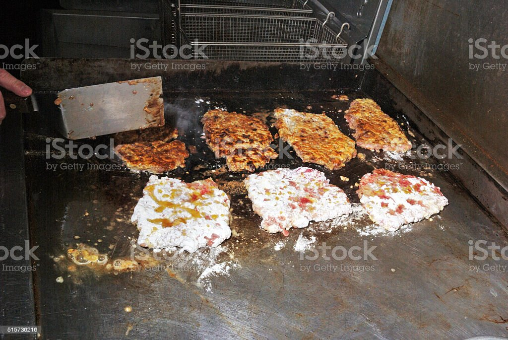 Cooking Chicken Fried Steaks stock photo