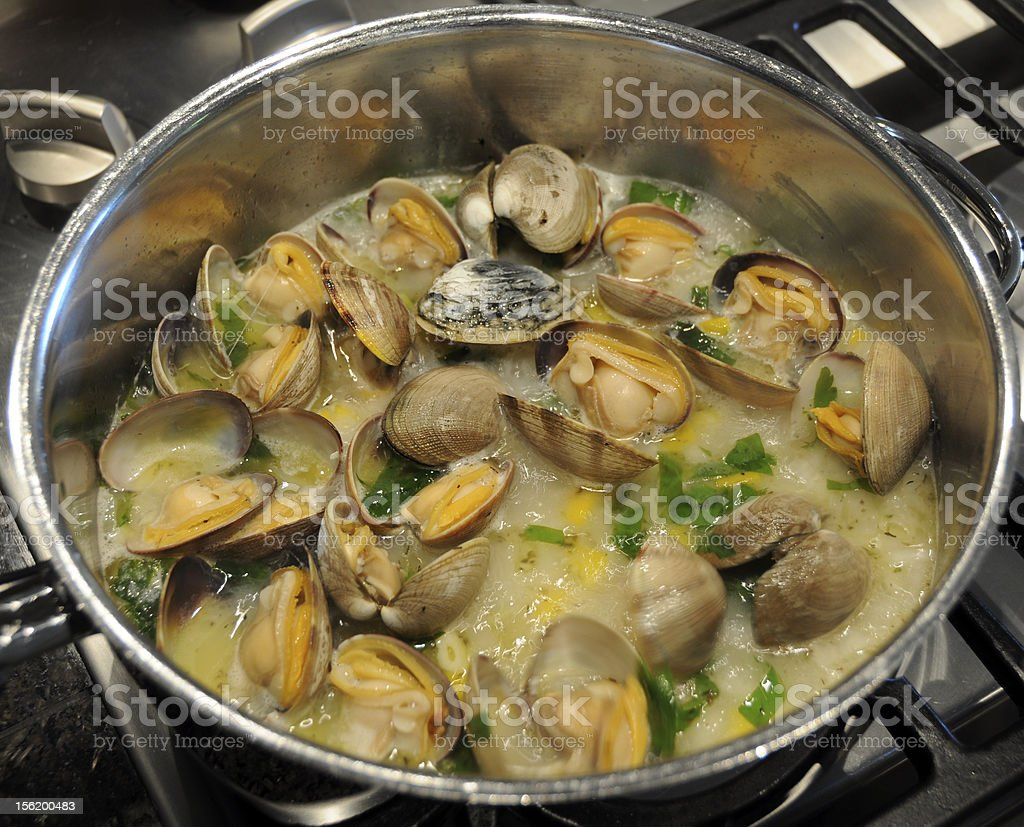 Cooking clams in a white wine sauce royalty-free stock photo