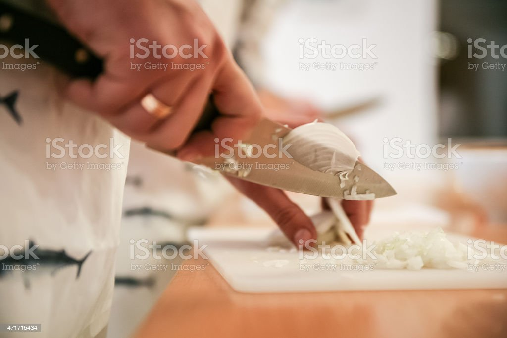 Cooking Classes  Instructor Teaches How Cutting onion stock photo