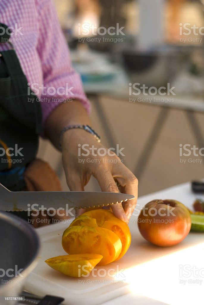 Cooking Classroom Instructor Teaches How Cutting Vegetable Food & Heirloom Tomatoes royalty-free stock photo