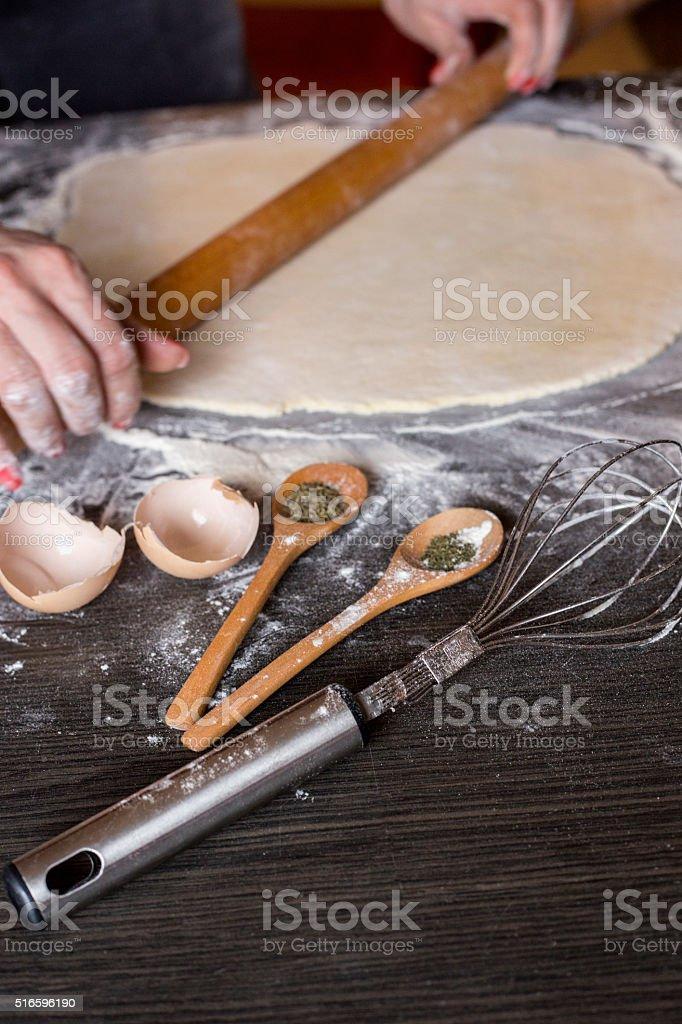 Cooking dumplings. Rolling dough for dumplings. stock photo
