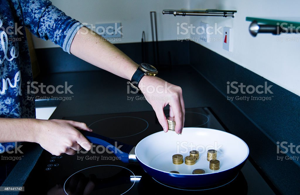 Cooking euros in a pan stock photo