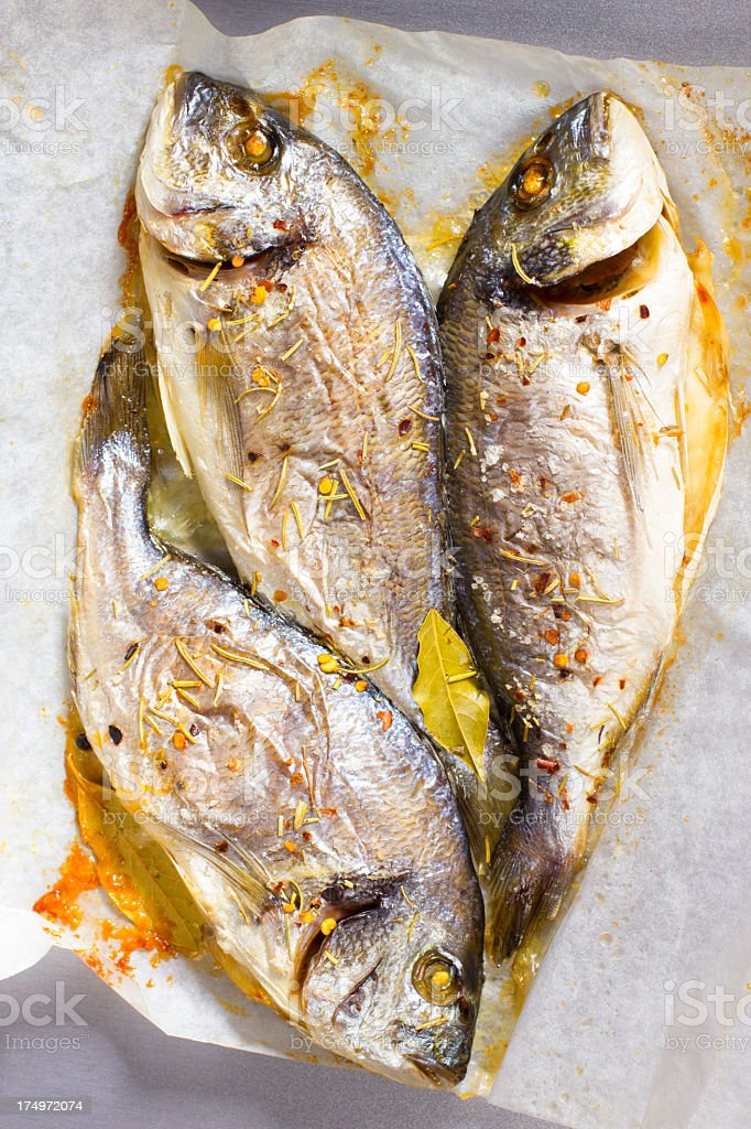 cooking fish paper stock photo