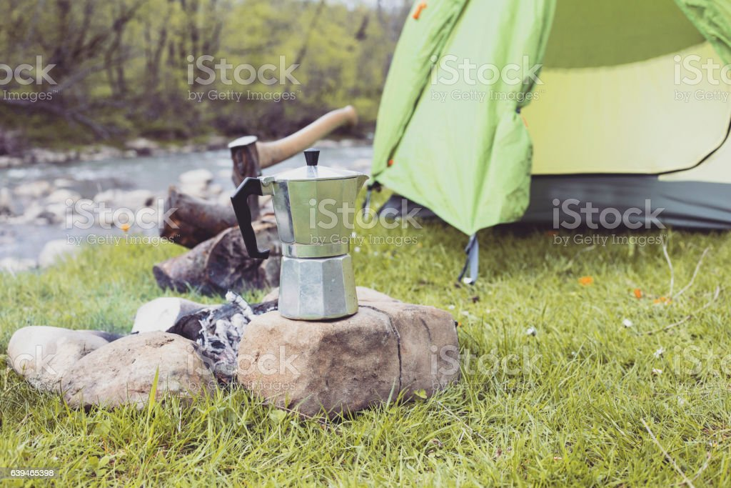 Cooking food in the camp. stock photo