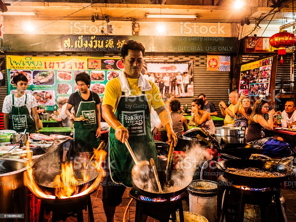 Cooking food in the street Chinatown Bangkok Thailand stock photo