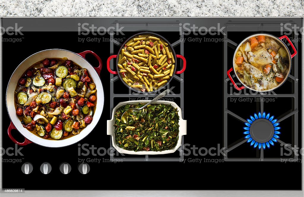 Cooking Food on a Gas Stove top panoramic view stock photo