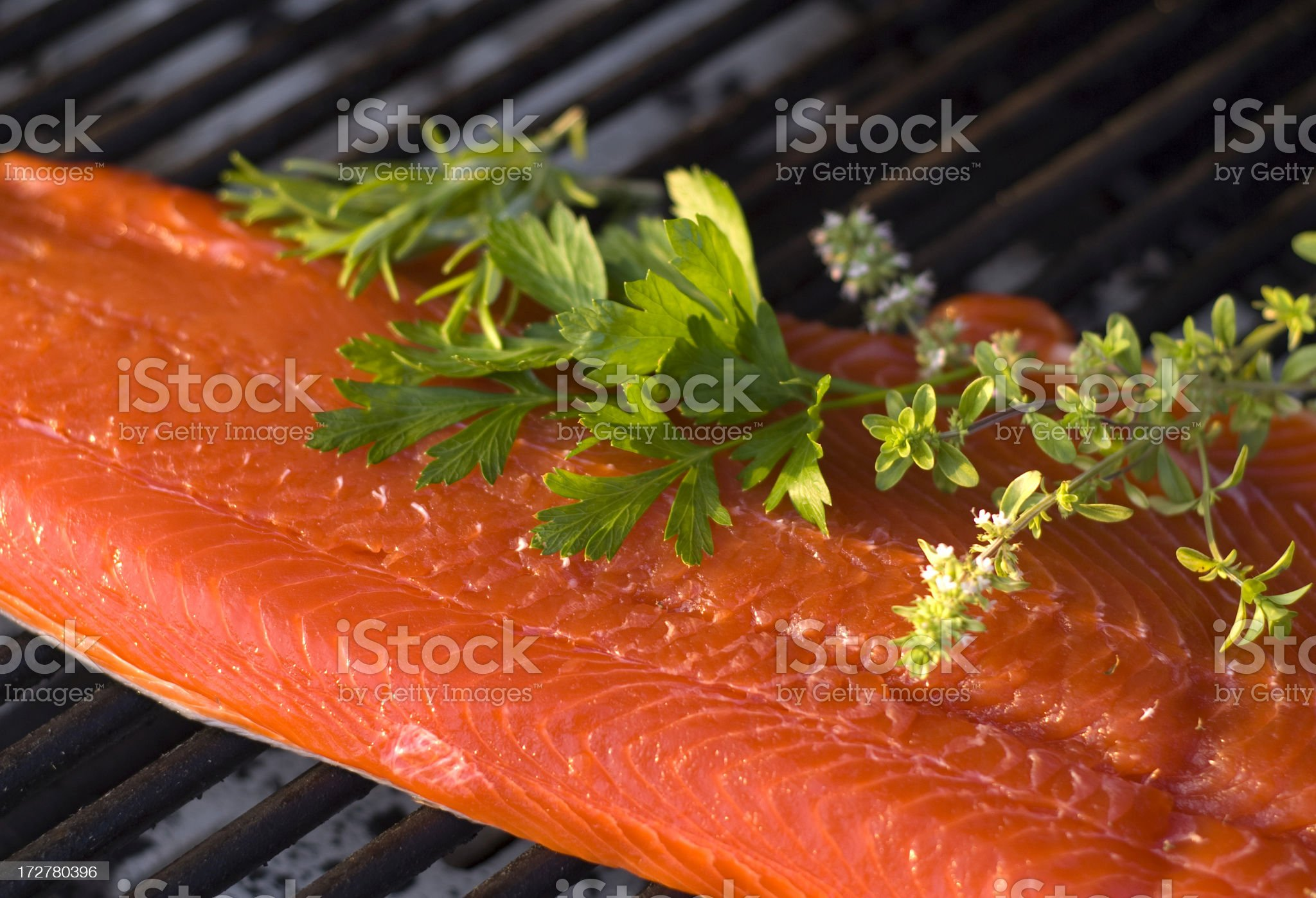 Cooking Fresh Seafood, Raw Sockeye Salmon Fish Fillet & Barbeque Grill royalty-free stock photo