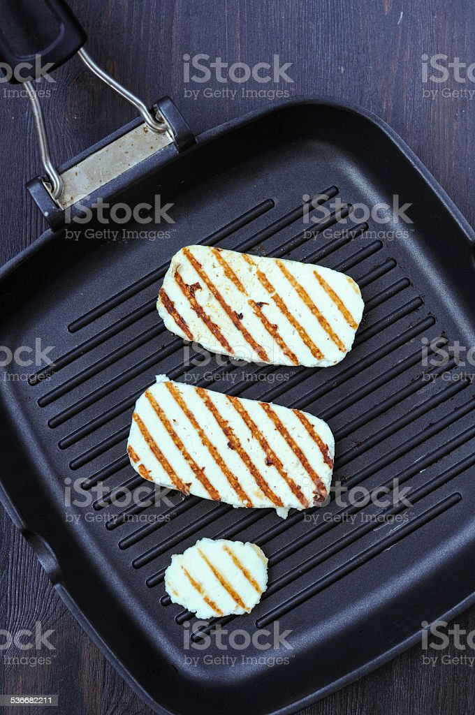 Cooking fried cheese on the grill pan stock photo