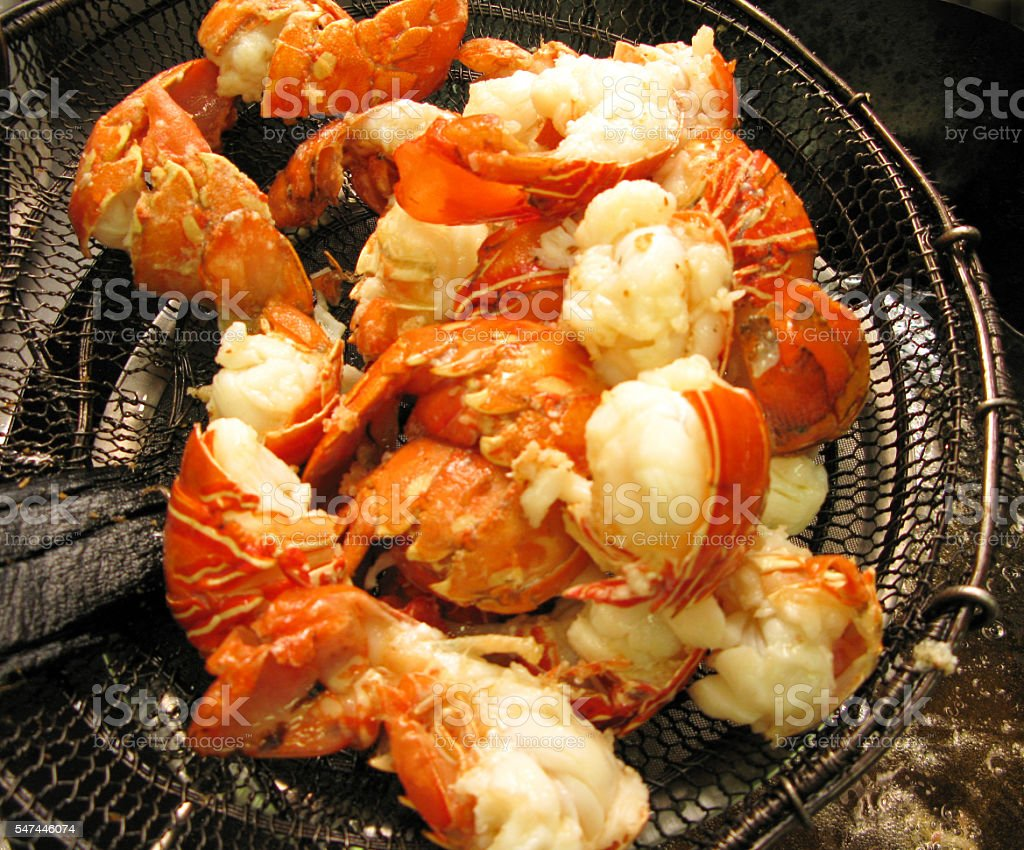 cooking fried lobster in restaurant stock photo