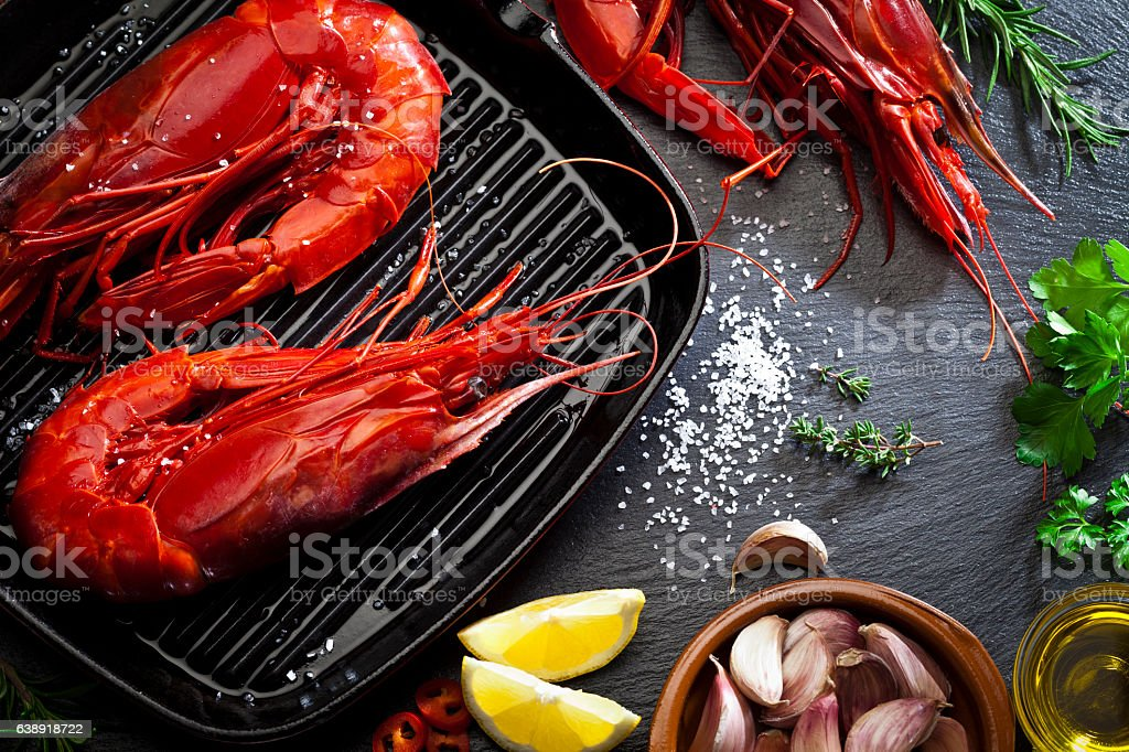 Cooking giant red shrimps in a grill stock photo