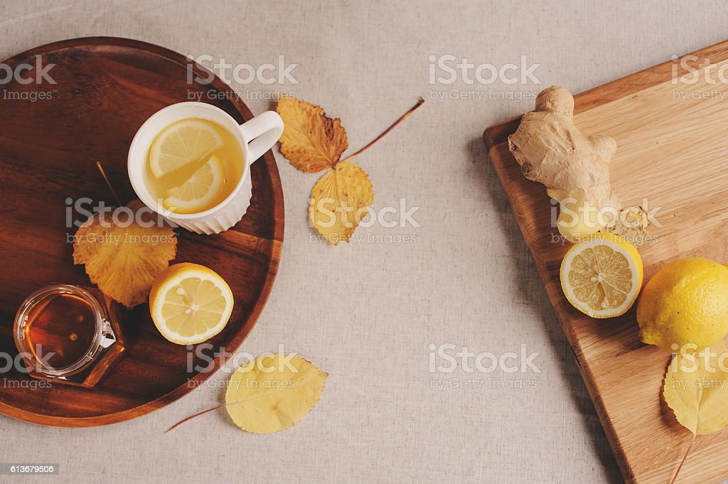 cooking ginger, lemon and honey hot tea at home stock photo