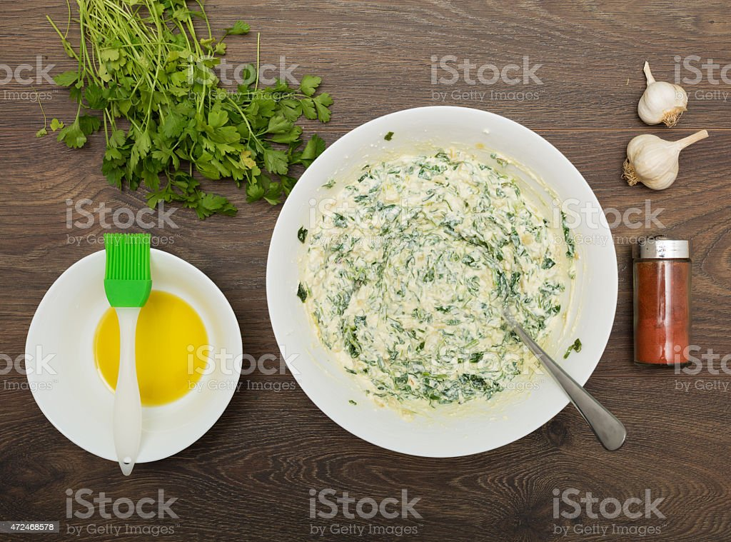 Cooking Greek spinach and feta pie stock photo
