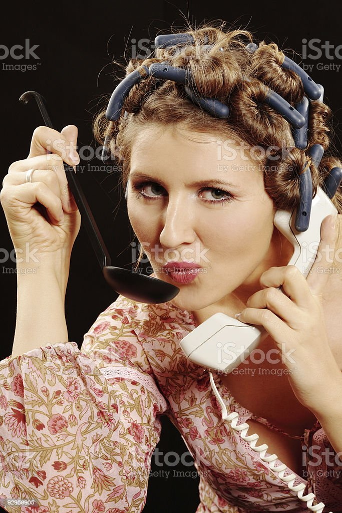 Cooking Housemaid on the phone royalty-free stock photo