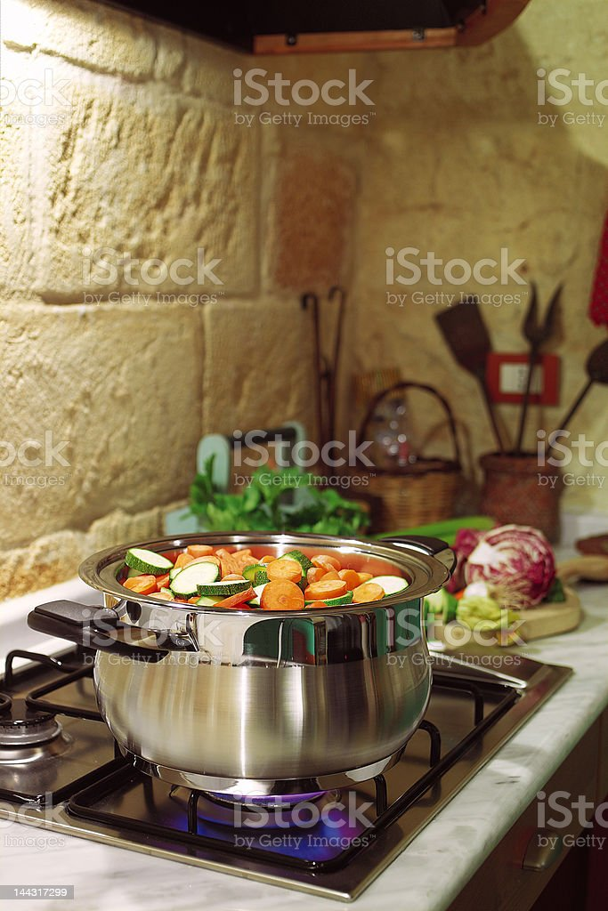 cooking in rustic kitchen stock photo