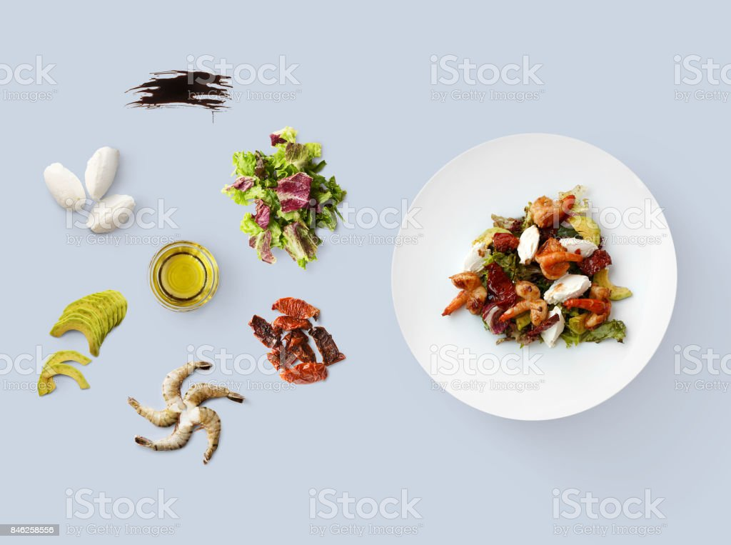 Cooking ingredients for healthy food, seafood salad, isolated on blue stock photo