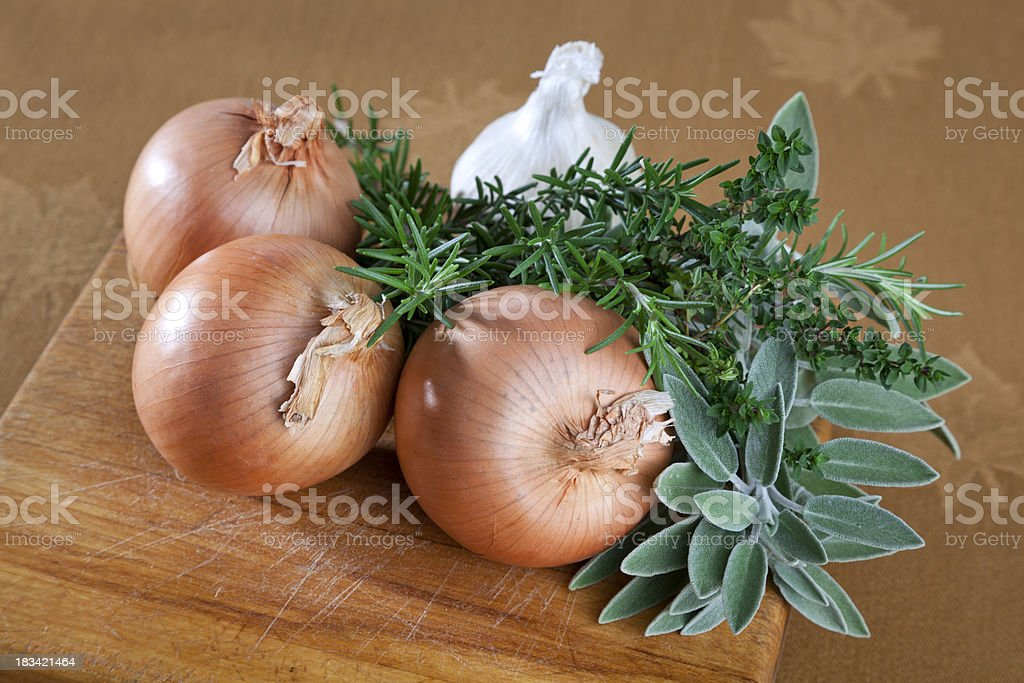 Cooking Ingredients; Fresh Garlic, Brown Onions, Rosemary, Sage & Thyme Herbs royalty-free stock photo