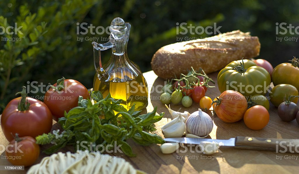 Cooking Ingredients & Olive Oil, Vegetables, Bread, Italian Food, Pasta Dinner royalty-free stock photo
