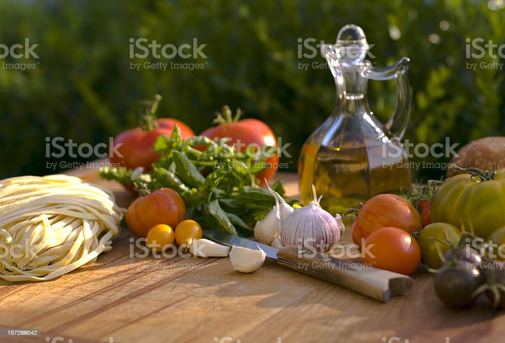 Cooking Ingredients & Olive Oil, Vegetables Food for Italian Pasta Dinner stock photo
