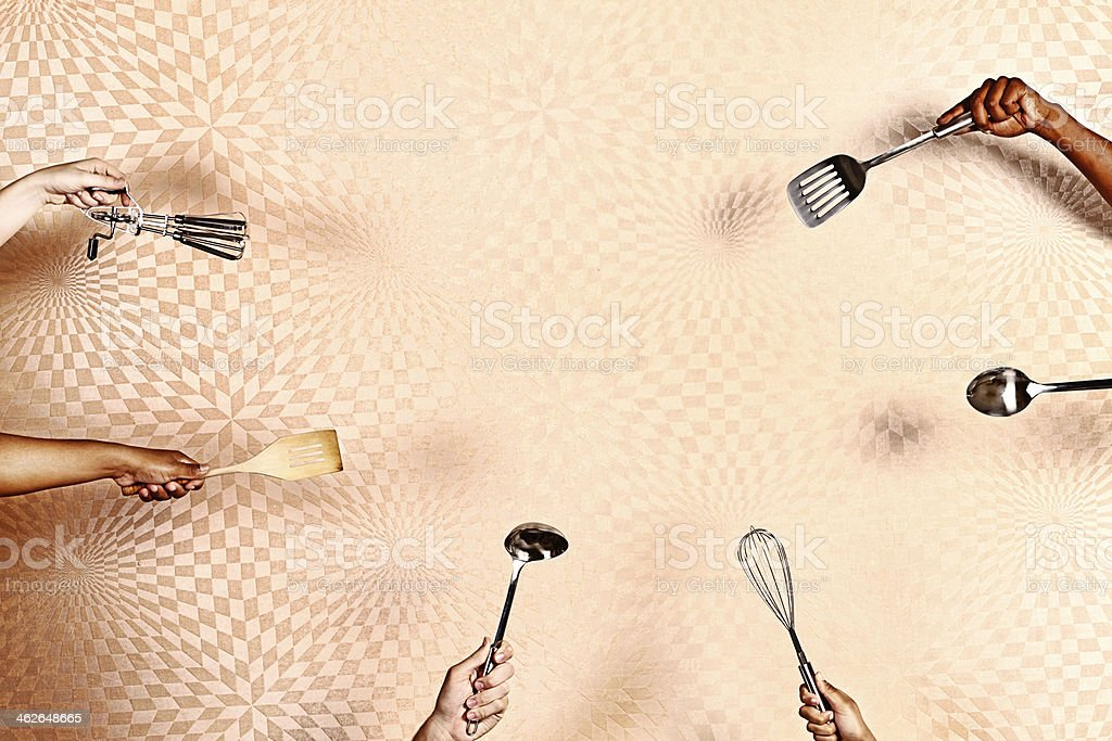 Cooking is magic! Kitchen utensils held against swirly psychedelic background stock photo