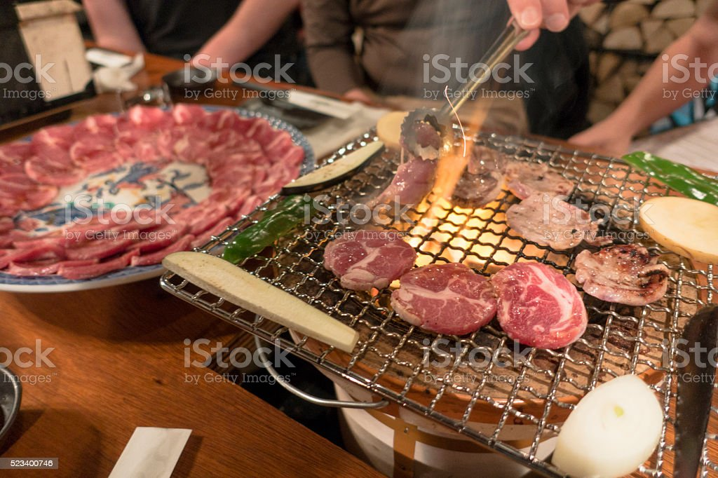 Cooking Jingisukan Yakiniku Korean BBQ Lamb on Grill stock photo