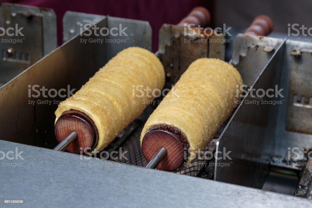Cooking Kurtos Kalacs: Traditional Hungarian Dessert stock photo