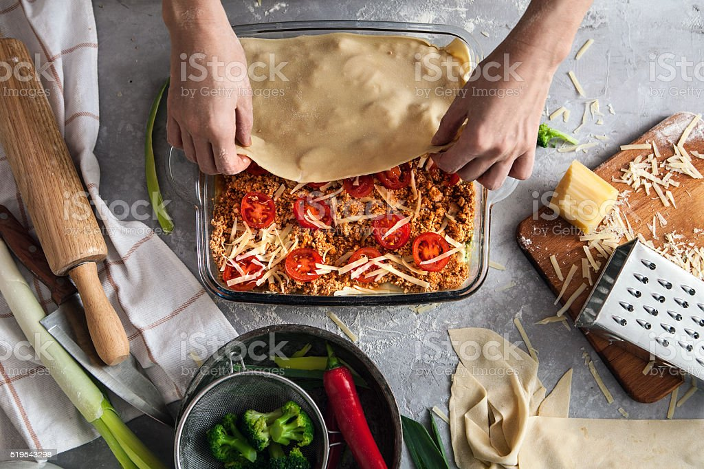 Cooking lasagna stock photo