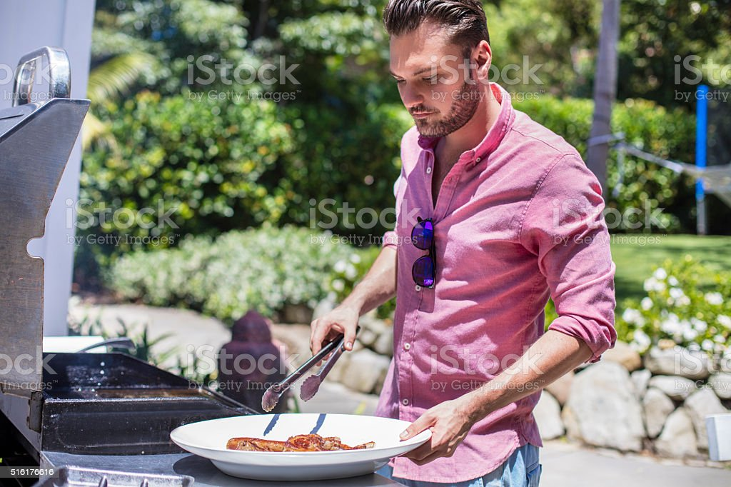 Cooking meat in the barbecue stock photo