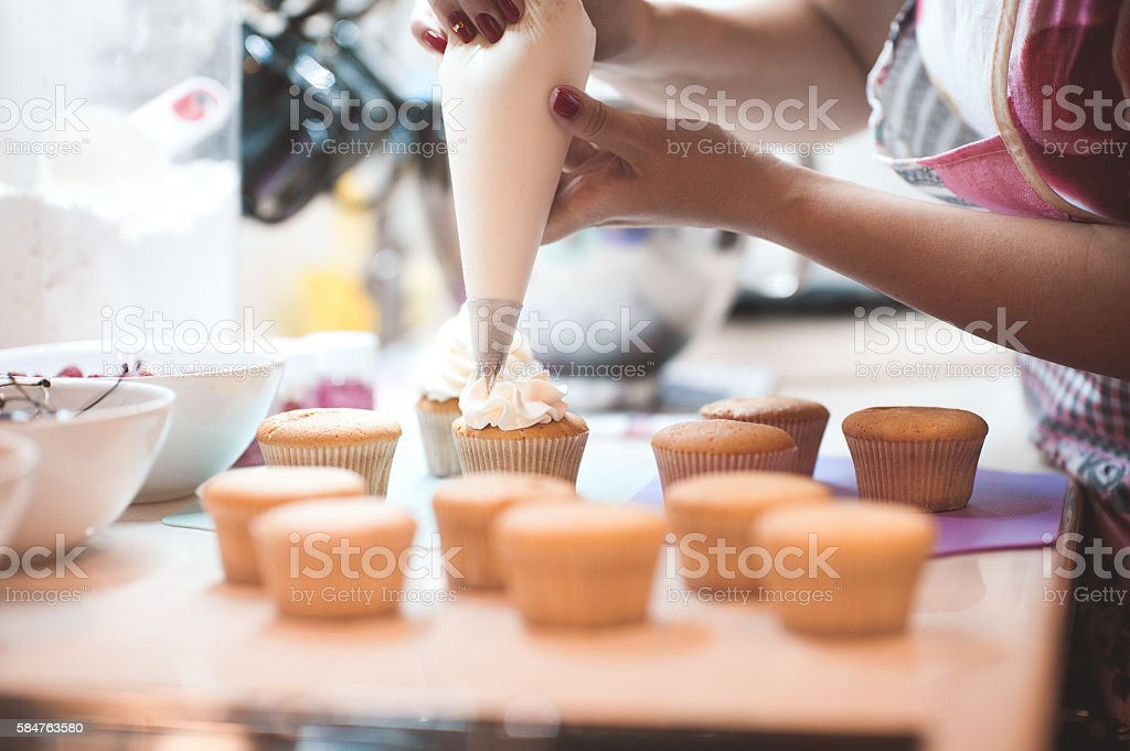 Cooking muffins closeup stock photo