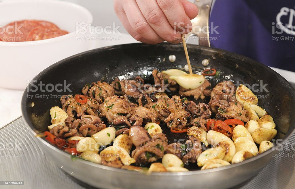 Cooking octopus. stock photo