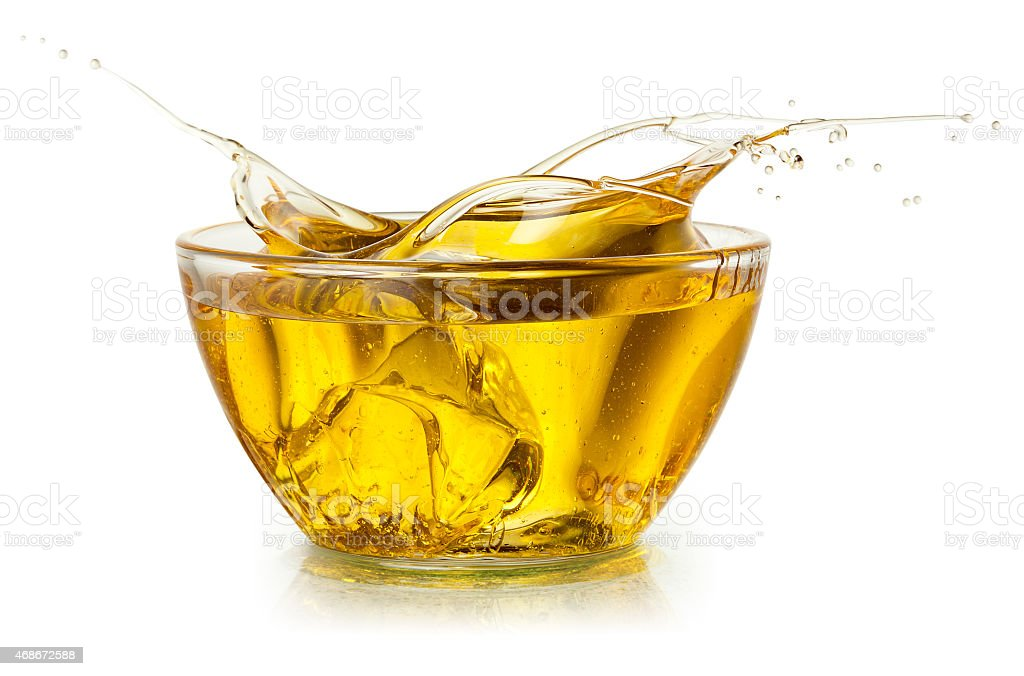 Cooking oil. Splash isolated on white. With clipping path. stock photo