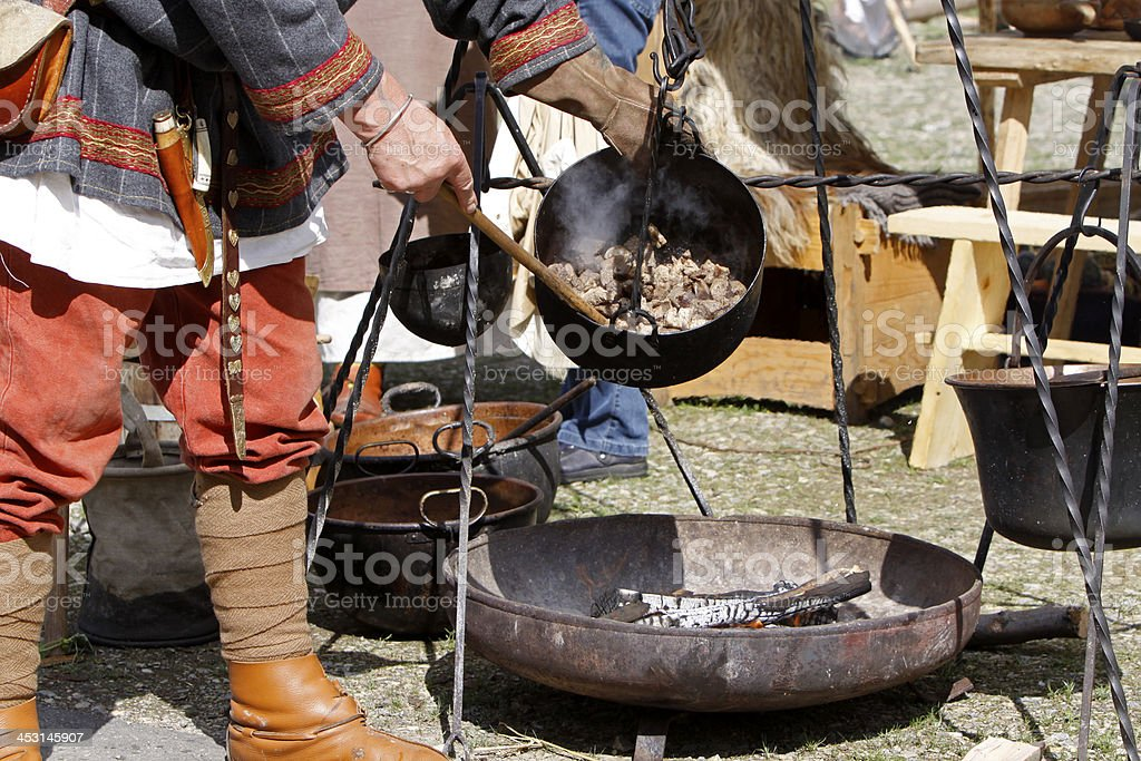 Cooking on a campfire royalty-free stock photo