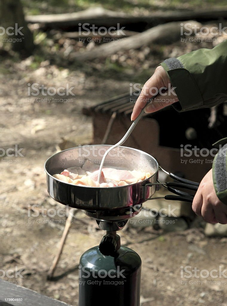 Cooking on Camping Stove royalty-free stock photo