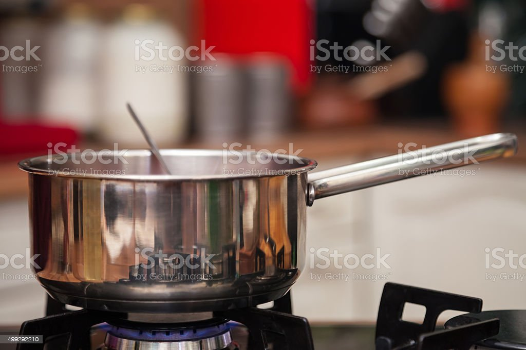 Cooking on gas stove in the kitchen. stock photo
