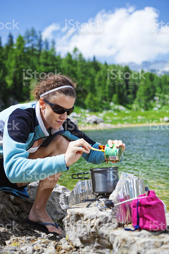 cooking outdoors on a small gas stove stock photo