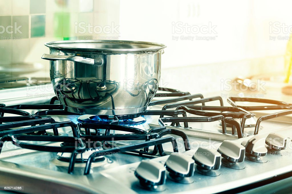 Cooking pan over stove. stock photo