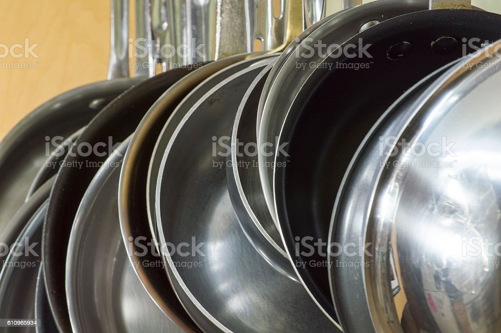 Cooking pans, hanging from Pan Rack stock photo