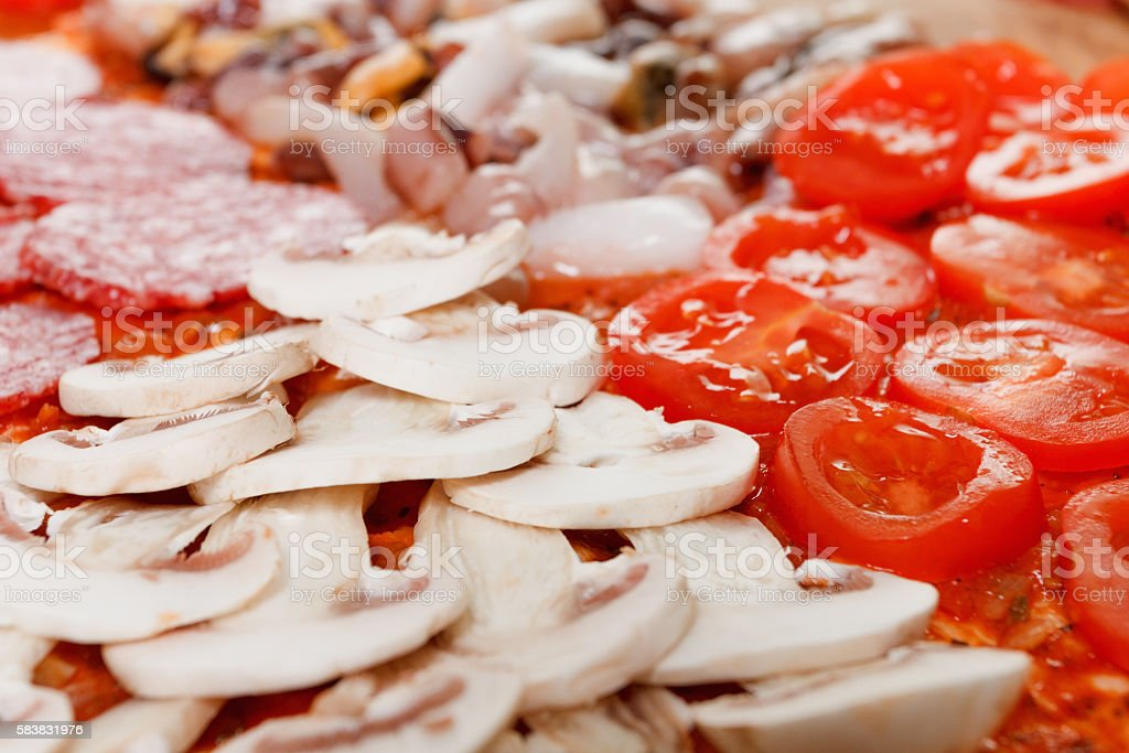 Cooking pizza four seasons stock photo