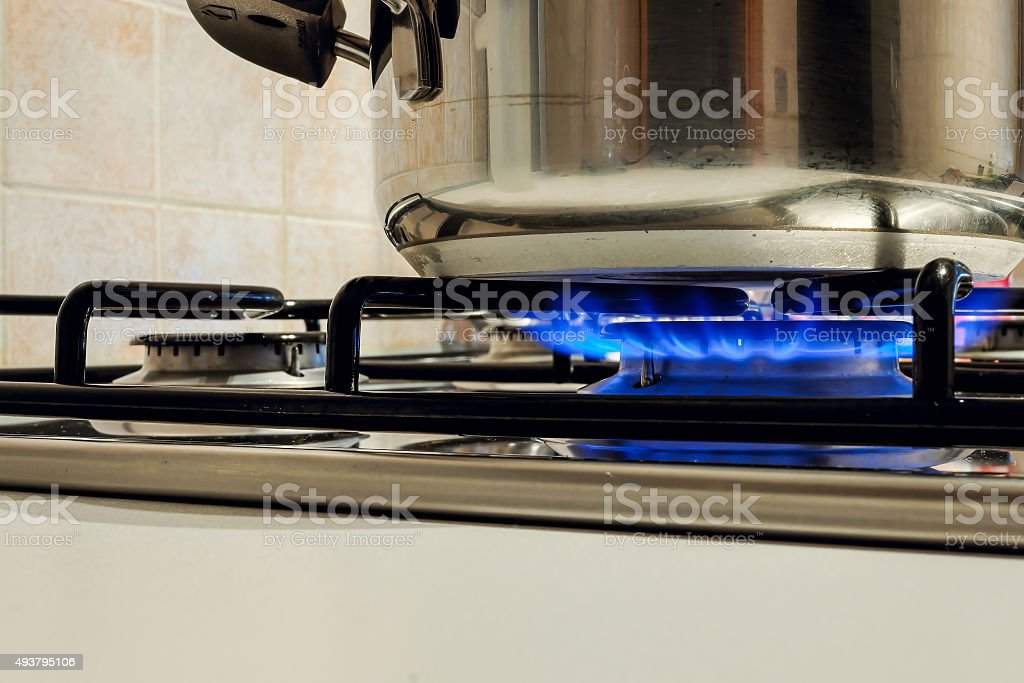 Cooking Plate: Cooktop - Gas Stovetop Burning in Light Background stock photo