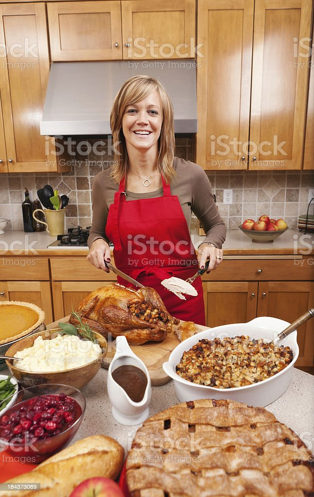 Cooking Preparing and Serving Thanksgiving Roast Turkey Dinner Vt royalty-free stock photo