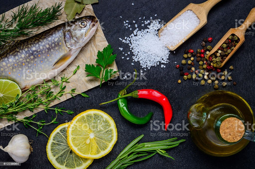 Cooking Raw Fish and Ingredients stock photo