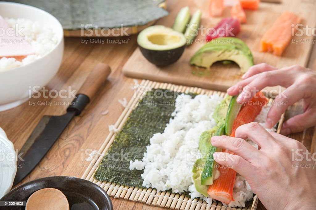 cooking roll sushi stock photo