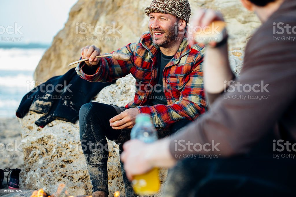 Cooking Sausage by the Beach stock photo