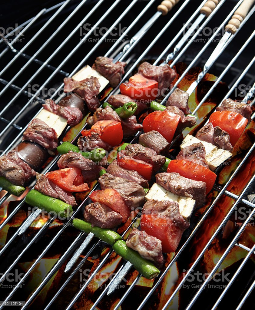 Cooking shish kebabs on a barbecue stock photo