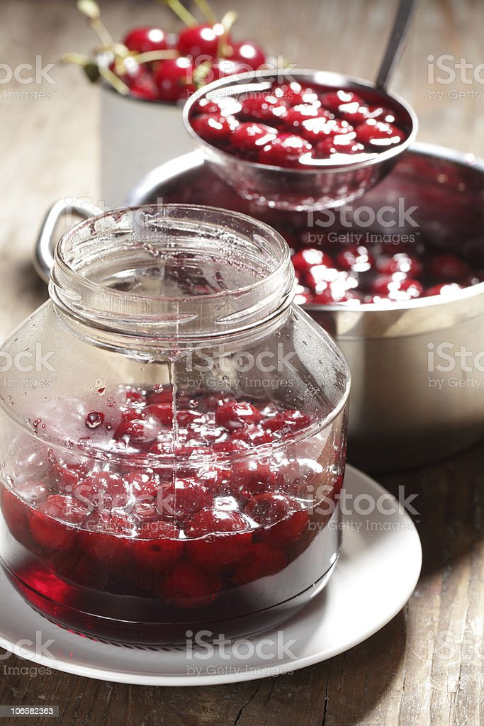 Cooking sour cherry jam royalty-free stock photo