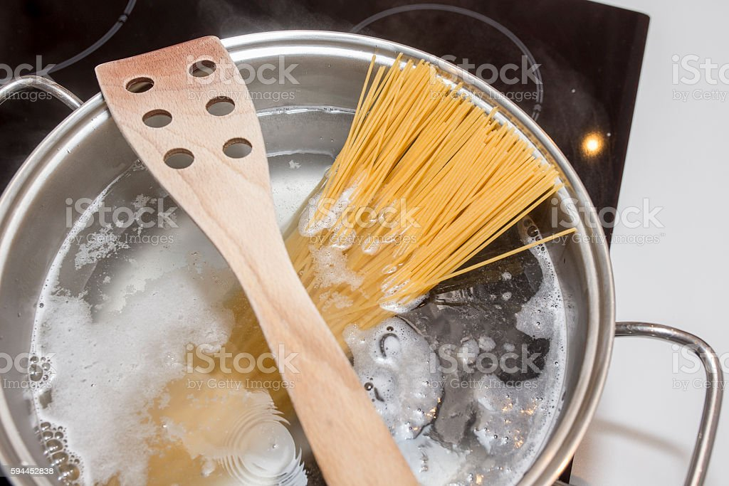 Cooking spaghetti with induction stock photo