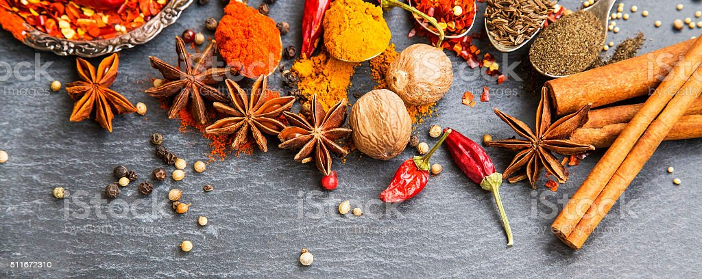 Cooking spices powders and seed, chili flakes, nutmeg and cinnam stock photo