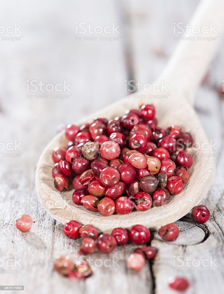 Cooking Spoon with Pink Peppercorns royalty-free stock photo