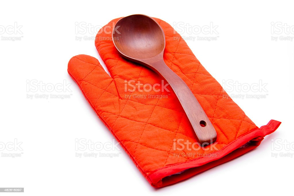 Cooking spoon with pot glove stock photo