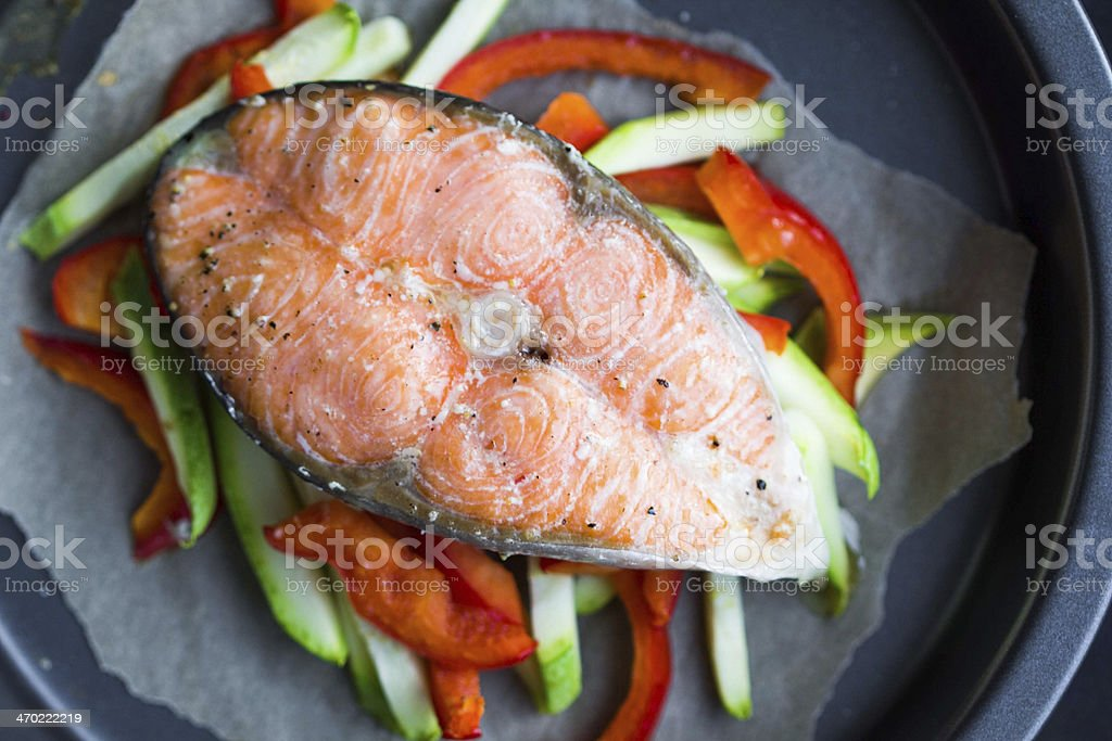 Cooking steak of red fish salmon on vegetables, zucchini, sweet stock photo